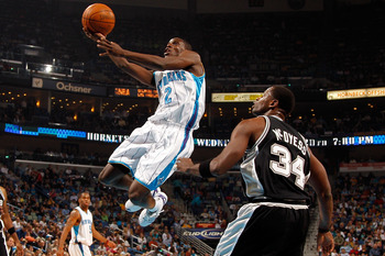 NEW ORLEANS - JANUARY 18:  Darren Collison #2 of the New Orleans Hornets makes a layup over Antonio McDyess #34 of the San Antonio Spurs at New Orleans Arena on January 18, 2010 in New Orleans, Louisiana.   NOTE TO USER: User expressly acknowledges and ag