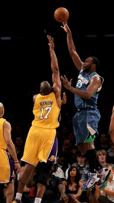LOS ANGELES - MARCH 19:   Al Jefferson #25 of the Minnesota Timberwolves shoots over Andrew Bynum #17 of the Los Angeles Lakers on March 19, 2010 at Staples Center in Los Angeles, California.  NOTE TO USER: User expressly acknowledges and agrees that, by