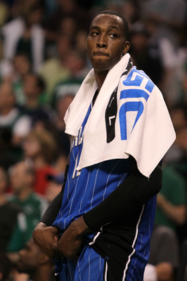 BOSTON - MAY 28:  Dwight Howard #12 of  the Orlando Magic looks on dejected after the Magic lost 96-84 against the Boston Celtics in Game Six of the Eastern Conference Finals during the 2010 NBA Playoffs at TD Garden on May 28, 2010 in Boston, Massachuset