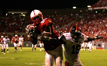 RALEIGH, NC - OCTOBER 27:  Ras-I Dowling #19 of the Virginia Cavaliers tries to stop Donald Bowens #80 of the North Carolina State Wolfpack as he catches the game-winning touchdown during their game at Carter-Finley Stadium October 27, 2007 in Raleigh, No