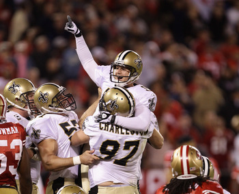 SAN FRANCISCO - SEPTEMBER 20:  Garrett Hartley #5 of the New Orleans Saints is lifted in the air by Jeff Charleston #97 after Hartley kicked the game winning field goal against the San Francisco 49ers at Candlestick Park on September 20, 2010 in San Franc