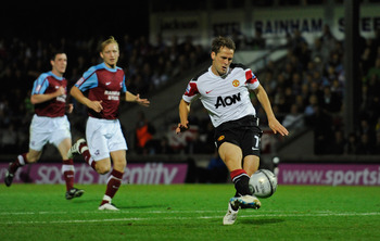 SCUNTHORPE, ENGLAND - SEPTEMBER 22: Michael Owen of Manchester United scores from the spot to make it 3-1 during the Carling Cup 3rd Round match between Scunthorpe United and Manchester United at Glanford Park on September 22, 2010 in Scunthorpe, England.