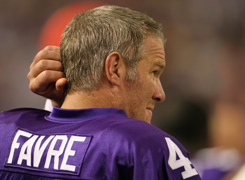 MINNEAPOLIS - SEPTEMBER 19:  Quarterback Brett Favre #4 of the Minnesota Vikings watches from the sidelines during the first half of the game against the Miami Dolphins on September 19, 2010 at Hubert H. Humphrey Metrodome in Minneapolis, Minnesota.  (Pho
