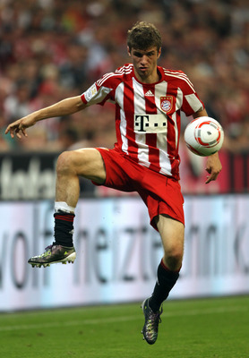 MUNICH, GERMANY - AUGUST 20:  Thomas Mueller of Bayern controls the ball during the Bundesliga match between FC Bayern Muenchen and VfL Wolfsburg at Allianz Arena on August 20, 2010 in Munich, Germany.  (Photo by Clive Brunskill/Getty Images)