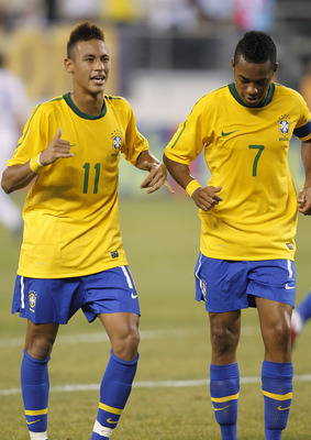 EAST RUTHERFORD, NJ - AUGUST 10: Neymar #11 and Robinho #7 of Brazil celebrate Neymar's goal against the U.S. in the first half of a friendly match at the New Meadowlands on August 10, 2010 in East Rutherford, New Jersey. (Photo by Jeff Zelevansky/Getty I