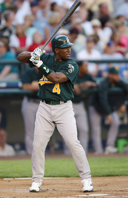 SEATTLE - JULY 23:  Miguel Tejada #4 of the Oakland A's bats against the Seattle Mariners during the game on July 23, 2003 at Safeco Field in Seattle, Washington.  The Mariners won 6-0.  (Photo by Otto Greule Jr/Getty Images)