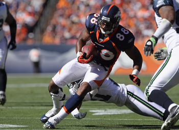 DENVER - SEPTEMBER 19:  Tightend Demaryius Thomas #88 of the Denver Broncos makes a reception as cornerback Kelly Jennings #21 of the Seattle Seahawks tries to make the tackle at INVESCO Field at Mile High on September 19, 2010 in Denver, Colorado. The Br