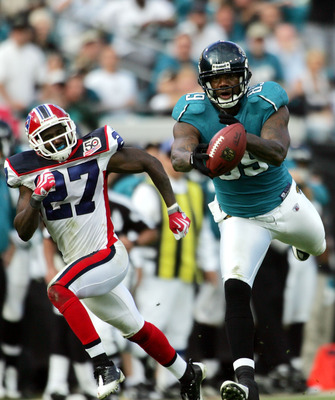 JACKSONVILLE, FL - NOVEMBER 22:  Tight end Marcedes Lewis #89 of the Jacksonville Jaguars catches a pass against cornerback Reggie Corner #27 of the Buffalo Bills at Jacksonville Municipal Stadium on November 22, 2009 in Jacksonville, Florida.  Jacksonvil