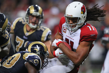 ST. LOUIS - SEPTEMBER 12: Larry Fitzgerald #11 of the Arizona Cardinals makes a catch against the St. Louis Rams during the NFL season opener at the Edward Jones Dome on September 12, 2010 in St. Louis, Missouri.  The Cardinals beat the Rams 17-13.  (Phot