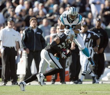 OAKLAND - NOVEMBER 9:  Steve Smith #89 of the Carolina Panthers collides with Nnamdi Asomugha #21of the Oakland Raiders at the Oakland-Alameda County Coliseum on November 9, 2008 in Oakland, California. (Photo by: Jed Jacobsohn/Getty Images)