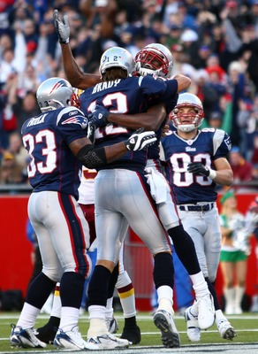 FOXBORO, MA - OCTOBER 28:  Randy Moss #81, Kevin Faulk #33 and Wes Walker #83 of the New England Patriots congratulate Tom Brady #12 after Brady ran the ball in for a touchdown in the first quarter against the Washington Redskins at Gillette Stadium Octob