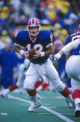 8 Sep 1996: Quarterback Jim Kelly of the Buffalo Bills drops back to pass during a play in the Bills 17-10 victory over the New England Patriots at Rich Stadium in Orchard Park, New York.