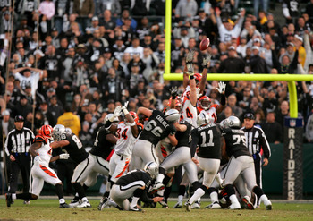 OAKLAND, CA - NOVEMBER 22:  Sebastian Janikowski #11 of the Oakland Raiders kicks the winning field goal with less than a minute to play against the Cincinnati Bengals at Oakland-Alameda County Coliseum on November 22, 2009 in Oakland, California.  (Photo