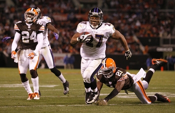 CLEVELAND - NOVEMBER 16: Ray Rice #27 of the Baltimore Ravens scores a 13-yard touchdown in the third quarter against Brodney Pool #21 and Eric Wright #24 of the Cleveland Browns at Cleveland Browns Stadium on November 16, 2009 in Cleveland, Ohio.  (Photo