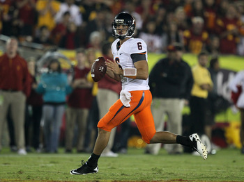 LOS ANGELES, CA - SEPTEMBER 11:  Quarterback Marc Verica #6 of the Virginia Cavaliers drops back to pass against the USC Trojans at Los Angeles Memorial Coliseum on September 11, 2010 in Los Angeles, California. USC won 17-14.  (Photo by Stephen Dunn/Gett