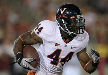 LOS ANGELES - SEPTEMBER 11:  Running back Raynard Horne #44 of the Virginia Cavaliers carries the ball against the USC Trojans at Los Angeles Memorial Coliseum on September 11, 2010 in Los Angeles, California. (Photo by Stephen Dunn/Getty Images)