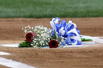 NEW YORK - JULY 16:  Two roses honoring the late owner George Steinbrenner of the New York Yankees and Yankee Stadium public address announcer Bob Sheppard are seen on home plate prior to the game against the Tampa Bay Rays on July 16, 2010 at Yankee Stad