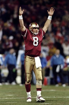 14 Dec 1998: Quarterback Steve Young #8 of the San Francisco 49ers celebrates during a game against the Detroit Lions at 3Com Park in San Francisco, California. The 49ers defeated the Lions 35-13.