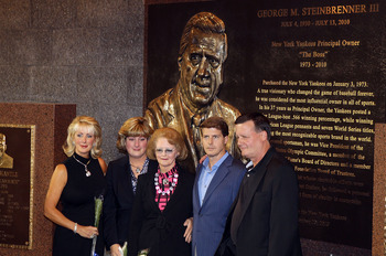 NEW YORK - SEPTEMBER 20:  The family of late New York Yankees owner George Steinbrenner poses in front of the newly unveiled monument prior to game against the Tampa Bay Rays on September 20, 2010 at Yankee Stadium in the Bronx borough of New York City.