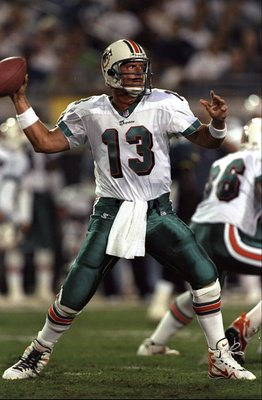 11 Oct 1998:  Quarterback Dan Marino #13 of the Miami Dolphins in action during a game against the Jacksonville Jaguars at the Alltel Stadium in Jacksonville, Florida. The Jaguars defeated the Dolphins 28-21. Mandatory Credit: Scott Halleran  /Allsport