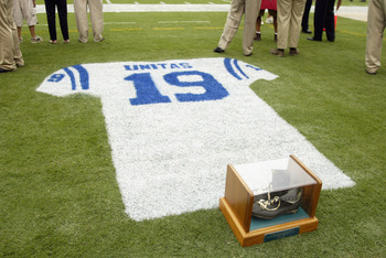BALTIMORE - SEPTEMBER  15:  Detail of an onfield tribute to Hall of Fame quarterback Johnny Unitas #19 of the Baltimore Colts with his signature black high tops in a glass case during halftime of the NFL game between the Tampa Bay Buccaneers and the Balti