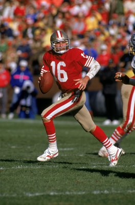 SAN FRANCISCO - NOVEMBER 13:  Quarterback Joe Montana #16 of the San Francisco 49ers runs with the ball as he looks down field for a receiver during a game against the Los Angeles Raiders at Candlestick Park on November 13, 1988 in San Francisco, Californ