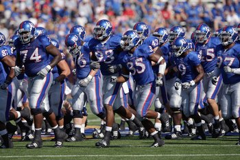 LAWRENCE, KS - SEPTEMBER 19: The Kansas Jayhawks jog onto the field before the game against the Duke Blue Devils on Kivisto Field at Memorial Stadium on September 19, 2009 in Lawrence, Kansas. (Photo by Jamie Squire/Getty Images)