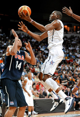 LAS VEGAS - JULY 24:  Kevin Durant #5 of the 2010 USA Basketball Men's National Team drives against JaVale McGee #14 of the 2010 USA Basketball Men's National Team during a USA Basketball showcase at the Thomas & Mack Center on July 24, 2010 in Las Vegas,
