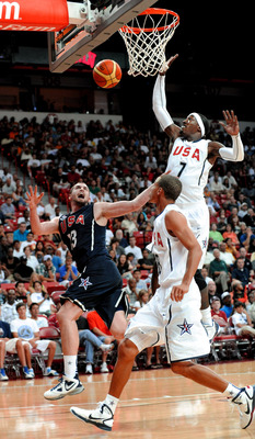 LAS VEGAS - JULY 24:  Kevin Love #13 of the 2010 USA Basketball Men's National Team reacts after being fouled by Stephen Curry #8 of the 2010 USA Basketball Men's National Team as teammate Gerald Wallace #7 trails the play during a USA Basketball showcase