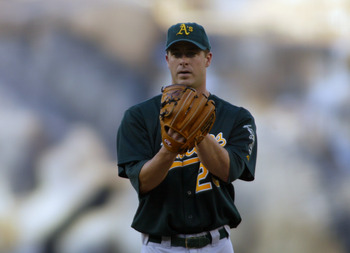 ANAHEIM, CA - SEPTEMBER 24:  Pitcher Mark Mulder #20 of the Oakland Athletics delivers a pitch against the Anaheim Angels during the game at Angel Stadium of Anaheim, on September 24, 2004 in Anaheim, California. The Angels won 6-2.  (Photo by Lisa Blumen