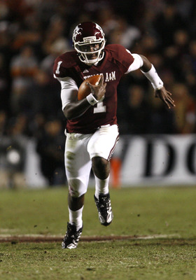 COLLEGE STATION, TX - NOVEMBER 26: Quarterback Jerrod Johnson #1 of the Texas A&M Aggies scrambles for a gain against the Texas Longhorns in the second half at Kyle Field on November 26, 2009 in College Station, Texas. The Longhorns defeated the Aggies 49