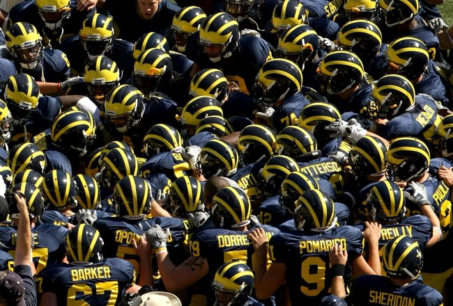 ANN ARBOR, MI - SEPTEMBER 19:  The Michigan Wolverines huddle before the game with the Eastern Michigan Eagles at Michigan Stadium on September 19, 2009 in Ann Arbor, Michigan.  Michigan won 45-17.  (Photo by Stephen Dunn/Getty Images)