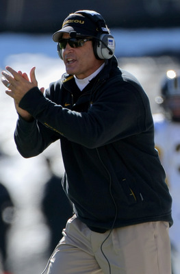 BOULDER, CO - OCTOBER 31:  Head coach Gary Pinkel of the Missouri Tigers leads his team against the Colorado Buffaloes at Folsom Field on October 31, 2009 in Boulder, Colorado.  (Photo by Doug Pensinger/Getty Images)