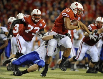 LINCOLN, NE - SEPTEMBER 25: Running back Roy Helu Jr. #10 of the Nebraska Cornuskers tries to slip the grip of defensive tackle Jake Steffen #46 of the South Dakota State Jackrabbits during second half action of their game at Memorial Stadium on September
