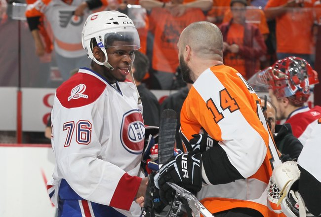 PHILADELPHIA - MAY 24:  PK Subban #76 of the Montreal Canadiens congratulates Ian Laperriere #14 of the Philadelphia Flyers after Game 5 of the Eastern Conference Finals during the 2010 NHL Stanley Cup Playoffs at Wachovia Center on May 24, 2010 in Philad