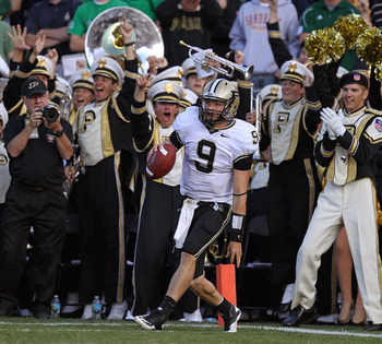 SOUTH BEND, IN - SEPTEMBER 04: Robert Marve #9 of the Purdue Boilermakers celebrates in the end zone after scoring a touchdown against the Notre Dame Fighting Irish at Notre Dame Stadium on September 4, 2010 in South Bend, Indiana. Notre Dame defated Purd