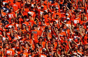 CHAMPAIGN, IL - SEPTEMBER 25:  University of Illinois Fighting Illini fans cheer during the game against the Purdue University Boilermakers on September 25, 2004 at Memorial Stadium in Champaign, Illinois.  Purdue defeated Illinois 38-30.  (Photo by Jonat