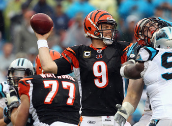 CHARLOTTE, NC - SEPTEMBER 26:  Carson Palmer #9 of the Cincinnati Bengals drops back to throw a pass against the Carolina Panthers during their game at Bank of America Stadium on September 26, 2010 in Charlotte, North Carolina.  (Photo by Streeter Lecka/G