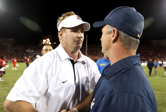 TUCSON, AZ - SEPTEMBER 25:  Head coach Mike Stoops of the Arizona Wildcats greets Jeff Tedford of the California Golden Bears following the college football game at Arizona Stadium on September 25, 2010 in Tucson, Arizona.  The Wildcats defeated the Golde