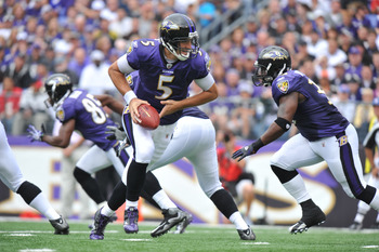BALTIMORE - SEPTEMBER 26:  Joe Flacco #5 of the Baltimore Ravens hands off against the Cleveland Browns  at M&T Bank Stadium on September 26, 2010 in Baltimore, Maryland. The Ravens lead the Browns at the half 14-10. (Photo by Larry French/Getty Images)