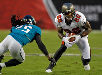 TAMPA, FL - AUGUST 28:  Tight end Kellen Winslow #82 of the Tampa Bay Buccaneers puts a move on safety Reggie Nelson #25 of the Jacksonville Jaguars during a preseason game at Raymond James Stadium on August 28, 2010 in Tampa, Florida.  (Photo by J. Meric