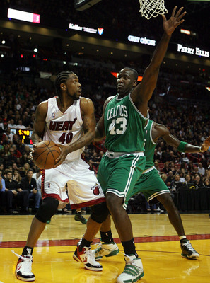 MIAMI - APRIL 23: Forward Udonis Haslem #40 of the Miami Heat is defended by center Kendrick Perkins #43 of the Boston Celtics in Game Three of the Eastern Conference Quarterfinals during the 2010 NBA Playoffs at American Airlines Arena on April 23, 2010