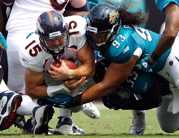 JACKSONVILLE, FL - SEPTEMBER 12:  Tyson Alualu #93 of the Jacksonville Jaguars tackles Tim Tebow #15 of the Denver Broncos during the NFL season opener game at EverBank Field on September 12, 2010 in Jacksonville, Florida.  (Photo by Sam Greenwood/Getty I