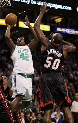 BOSTON - APRIL 27:  Tony Allen #42 of the Boston Celtics takes a shot as Joel Anthony #50 of the Miami Heat defends during Game Five of the Eastern Conference Quarterfinals of the 2010 NBA playoffs at the TD Garden on April 27, 2010 in Boston, Massachuset