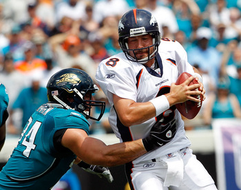 JACKSONVILLE, FL - SEPTEMBER 12:  Aaron Kampman #74 of the Jacksonville Jaguars attempts to tackle Quarterback Kyle Orton #8 of the Denver Broncos during the NFL season opener game at EverBank Field on September 12, 2010 in Jacksonville, Florida.  (Photo