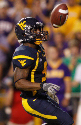 BATON ROUGE, LA - SEPTEMBER 25:   Jock Sanders #9 of the West Virginia Mountaineers celebrates after scoring a touchdown against the  Louisiana State University Tigers at Tiger Stadium on September 25, 2010 in Baton Rouge, Louisiana.  The Tigers defeated