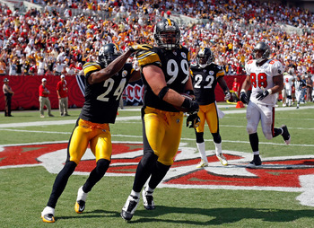TAMPA, FL - SEPTEMBER 26:  Defensive end Brett Keisel #99 of the Pittsburgh Steelers scores a touchdown after incepting a pass against the Tampa Bay Buccaneers during the game at Raymond James Stadium on September 26, 2010 in Tampa, Florida. The undefeate