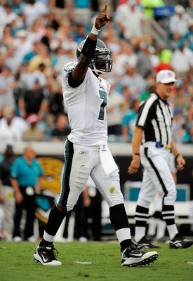JACKSONVILLE, FL - SEPTEMBER 26:  Quarterback Michael Vick #7 of the Philadelphia Eagles celebrates after throwing a touchdown pass in the first quarter against the Jacksonville Jaguars at EverBank Field on September 26, 2010 in Jacksonville, Florida.  (P