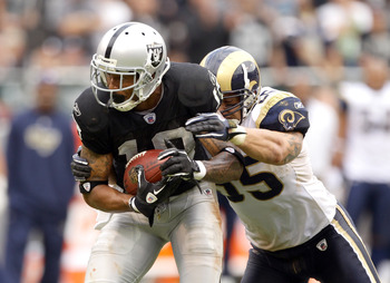 OAKLAND, CA - SEPTEMBER 19:  James Laurinaitis #55 of the St. Louis Rams tackles Louis Murphy #18 of the Oakland Raiders at the Oakland-Alameda County Coliseum on September 19, 2010 in Oakland, California.  (Photo by Ezra Shaw/Getty Images)