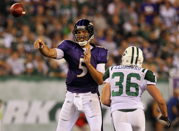 EAST RUTHERFORD, NJ - SEPTEMBER 13: Joe Flacco #5 of the Baltimore Ravens passes against Jim Leonhard #36 of the New York Jets during the Jets home opener at the New Meadowlands Stadium on September 13, 2010 in East Rutherford, New Jersey.  (Photo by Jim